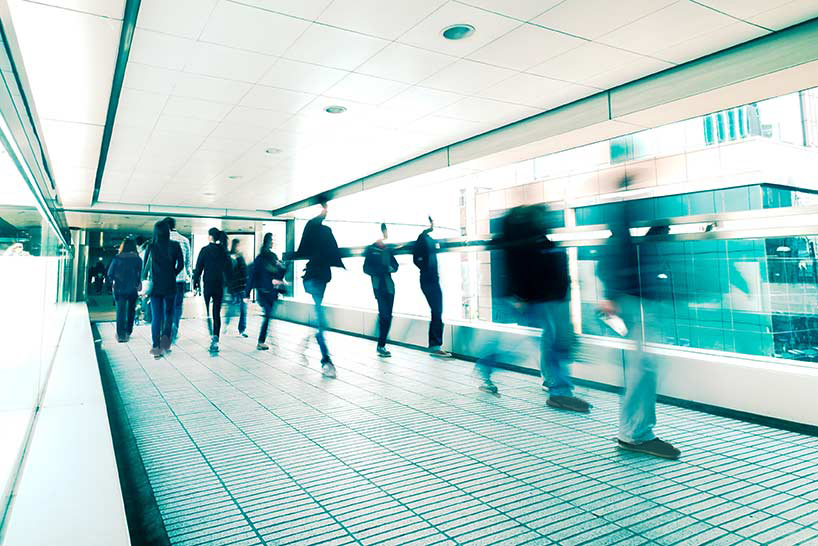Abstract city background. Blurred image of people moving in tunnel at crowded street. Hong Kong. Blur effect, vintage style toning